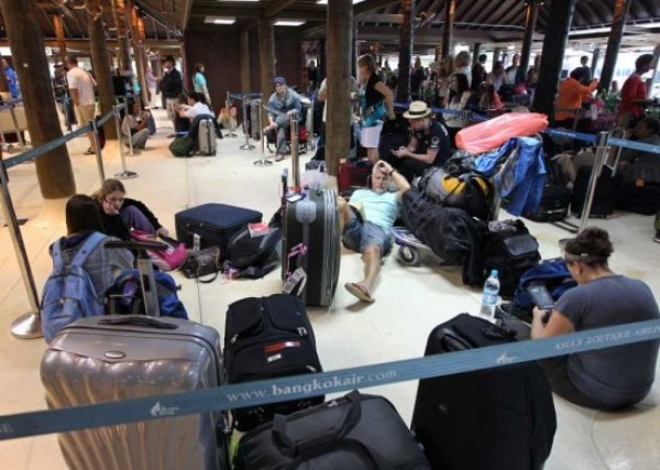 Stranded foreign and Thai travellers sit next to belongings at Samui airport in the resort island of Koh Samui, Surat Thani province, southern Thailand, 28 March 2011 after flights were cancelled. . All flights were cancelled and ferry services to the tourist islands of Koh Samui, Phangan and Koh Tao were suspended as waves reached 4 metres high in the Gulf of Thailand due to the heavy rain persist in many areas over the south affecting about 38,000 families. EPA/RUNGROJ YONGRIT  Stranded foreign and Thai travellers sit next to belongings at Samui airport in the resort island of Koh Samui, Surat Thani province, southern Thailand, 28 March 2011 after flights were cancelled. . All flights were cancelled and ferry services to the tourist islands of Koh Samui, Phangan and Koh Tao were suspended as waves reached 4 metres high in the Gulf of Thailand due to the heavy rain persist in many areas over the south affecting about 38,000 families. EPA/RUNGROJ YONGRIT