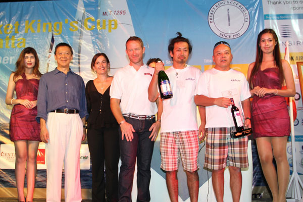 (In photo, from left): Narong Pattamasaevi, Chairman Boathouse Inn and Restaurant Co., Ltd. (2nd left); Marie Fleury, General Manager of Boathouse Resort (3rd left), Daniel Schwalb, Commercial Director of Siam Winery(4th left); and the winners from the all Japanese team The Beaver (2nd and 3rd right), at the awards ceremony on the first day of racing at the legendary Phuket King's Cup Regatta, hosted jointly by Mont Clair and Boathouse Resort on the Beach.